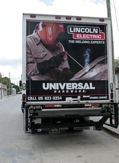 Universal Hardware truck seen in Orange Walk Town.